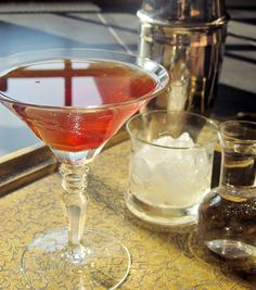 Whiskey Manhattan: Ice,  2 ounces whiskey,  2 ounces sweet vermouth,  Maraschino cherry. In a cocktail shaker filled with ice add whiskey and sweet vermouth. Stir until well chilled.  Strain into a chilled martini glass, and garnish with one maraschino cherry.  Serve the ice on the side