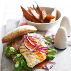 Chicken burger with sweet potato wedges recipe. This chicken burger is healthier, quicker and cheaper than going out for a takeaway. Why not try blue cheese instead of chilli sauce?