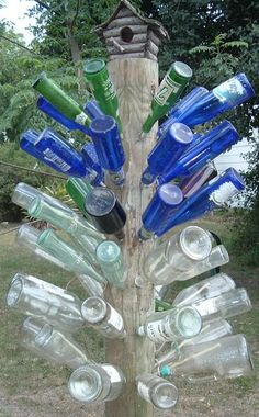 It used to be that you could see bottle trees scattered all over the Southern landscape. Usually in the country or along the bayous of Louisiana, Mississippi, Tennesee, and Alabama, bottle trees are a colorful folk tradition with the purpose of. Wine Bottle Trees, Wine Bottle Art, Blue Bottle, Outdoor Projects, Garden Projects, Diy Projects, Level Design, Bottles And Jars, Brown Bottles