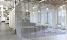 Woven wire drapery by Cascade Coil at the Google Headquarters in San Francisco, California. Creative room divider to match the rest of Google's innovative office design.