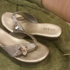 Guess silver sparkly wedges These are really pretty wedge sandal with  silver sparkle and a little heart lock on it never worn just a pretty wedge sandal by Guess Guess Shoes Sandals