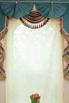 The decadence and sophistication of the Romantic Era are reimagined in this Paris Salon fan style blue chenille swag valance curtains. This unique style, beige velvet swags overlapped with blue chenille fans with hand made fabric flowers stitched to the center, is one of our new favorite design additions. beige, blue, curtain, curtains, draperies, drapes, elegant, floral, fringe, gold, jabots, luxury, ready made, silk, swag, swags, valance, valances, window treatment,