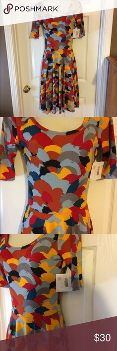 "Lularoe ""Nicole"" dress  size - xs. Lularoe the Nicole dress boasts a fitted bodice, flattering scoop neck, mid length sleeves and a full circle skirt it is simultaneously casual and dressy whatever the day or night calls for this dress will get it done in beautiful colors brand new with tags never worn very feminine! LuLaRoe Dresses"
