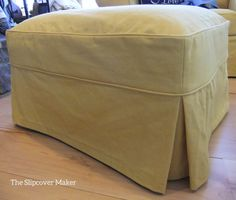 Washed yellow denim slipcover tailored for an over sized ottoman.