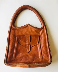 Cognac colored vintage bag 💼 It's definitely worn but I like the shape so much! It's not something you see everyday right? The leather is so soft and supple. Vintage Bag, Vintage Shops, Leather Bag, Satchel, Shape, Create, Link, Bags, Etsy