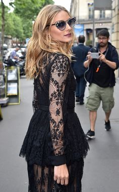 The fashion mogul looks stunning in a black lace dress during Paris Fashion week.