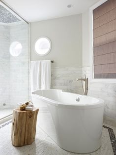 If you long to linger in the soothing jets and serene bubbles of a whirlpool tub, buy a model that's roomy and doesn't strain your muscles when you lean back. Bathroom Renos, Master Bathroom, Bathroom Inspiration, Home Decor Inspiration, Deep Soaking Tub, Deep Tub, Soaking Tubs, Shower Surround, Bathroom Design Small