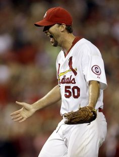 St. Louis Cardinals starting pitcher Adam Wainwright celebrates after throwing a complete baseball game to defeat the Atlanta Braves, Friday, Aug. 23, 2013, in St. Louis. The Cardinals won 3-1. (AP Photo/Jeff Roberson)
