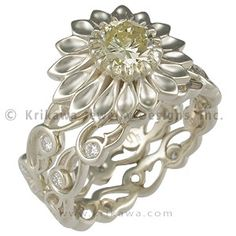 Green Gold Daisy Delicate Leaf Bridal Set - If you are interested in our Delicate Leaf rings and are looking for something elaborate, this may be the design for you.  This artistic engagement ring has a daisy for a bezel!  Your diamond or precious gemstone will be at the center of the blossom.  Ideal cut diamonds accent the band.  - This unique bridal set was handcrafted out of green gold.  It features the 3 mm Delicate Leaf Diamond Wedding Band.