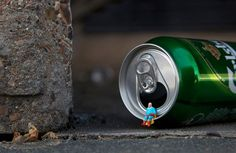 The street art of slinkachu: Little people of the city. Meant to encourage people to be more aware of their surroundings. Reflects the loneliness of living in a big city.