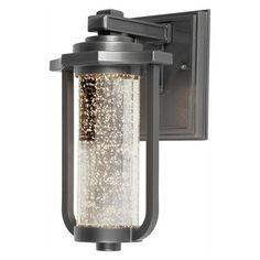 ARTCRAFT North Star H Slate LED Outdoor Wall Light at Lowe's. The Dazzling North Star collection, incases a seeded optic glass. The LED light shines through the glass creating a sparkling glow watt LED producing Led Exterior Lighting, Outdoor Barn Lighting, Led Outdoor Wall Lights, Outdoor Wall Lantern, Outdoor Wall Sconce, Outdoor Walls, Wall Sconce Lighting, Wall Sconces, One Light