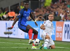 France's midfielder Paul Pogba (L) and Albania's midfielder Amir Abrashi vie for the ball during the Euro 2016 group A football match between France and Albania at the Velodrome stadium in Marseille on June 15, 2016. / AFP / BORIS HORVAT