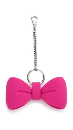 A lighthearted Marc by Marc Jacobs x Disney® bag charm in matte rubber, shaped like a bow tie, inspired by Alice in Wonderland.
