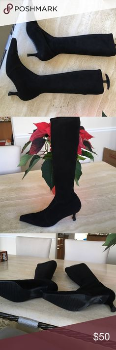 Stuart Weitzman black suede boot Worn twice but excellent condition! Size 8 but I wear a 7 and found them comfortable. No zippers, pull on. Narrow calf, but stretchy so there's a little room. Gorgeous and I got many compliments when I wore them Stuart Weitzman Shoes Heeled Boots