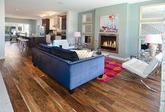 Arista Showhome in EvansRidge - beautiful hardwood floors and a trendy paint color run through this main floor open plan