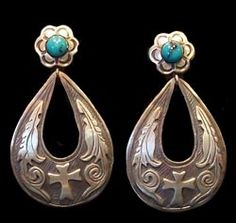 "Old world charm with modern attitude!    Hand crafted one at a time in Mexico, these earrings are artful and charming.     2 1/8"" with post"