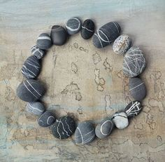 love the striped stones. collect them on the beach.  this is not my photo, but lovely.