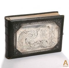 Photo album with German, Russian and Japanese portraiture. Leather Case decorated with engraved silver onlays. Stamp Anatoly Artsybashev, Moscow 1894. Inside inscription: Vladivostok 1902.