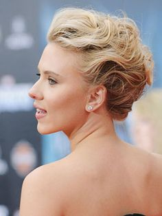 Scarlett Johansson's tendrils are twisted and loosely pinned for a sweet yet sophisticated style.