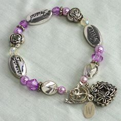 """Personalized Sister Friend Forever Bracelet. A Sister is a Friend Forever! Choose your sister's initial that will be engraved on one side of the silver plated charm. The words """"Sister"""" """"Friend"""" """"Forever"""" are inscribed on the 3 silver plated ovals."""