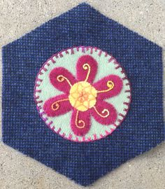 Flower Medallion--All thread #8 Perle cotton; Center whipped Spiderweb wheel over lazy daisies; Petals-Stem Stitch and 2 wrap French Knot; outside circle edge-Up & Down Buttonhole stitch