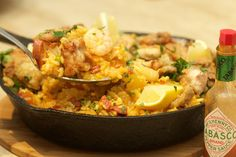 Chicken chorizos paella with wild North Atlantic prawns served with crusty bread a splash of tobasco and squeeze of lemon garnish of flat leaf parsley using knorr stock pots. Wild North, Boneless Chicken Thighs, Prawn, Chorizo, Parsley, Paella, Potato Salad, Fries, Pots