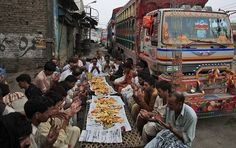 Pakistani truck drivers, chant prayer before breaking their fast, on the third day of the Muslim holy fasting month of Ramadan, in Lahore, Pakistan, Monday, July 23, 2012. Muslims from Morocco to Afghanistan are steeling themselves for the toughest Ramadan in more than three decades with no food or drink, not even a sip of water during the hottest time of the year. (AP Photo/K.M. Chaudary)