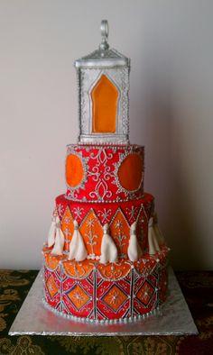 pink and orange Indian henna cake with illuminated 4 sided sugar lantern topper