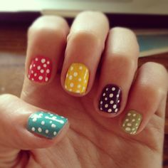 A skittles mani is even more fun with polka dots!