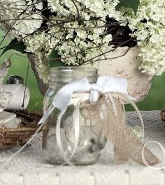 Listing is for ONE Mason Jar...Decorate you Special Event by filling jars with lovely flowers.  Wrapped in Satin and Jute Ribbon...Or Ribbon of your choice.Decorate any outdoor celebration with these Sweet Jars.. Can also be made to hang from a tree , shepherds hook or just sitting on the table as a centerpiece. $6.50