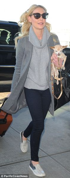 Katherine Heigl doesn't let dog Gertie out of her sight at JFK #dailymail