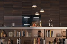 This Italia Kitchen with Natural Touch Finish(NTF) cabinetry in chestnut wood is the perfect backdrop for the island in Arclinea's new bronze stainless steel PVD finish.