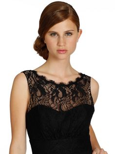 72f129fe9b18b This sophisticated black Occasions by Jim Hjelm dress has a chiffon fabric  with an illusion neckline