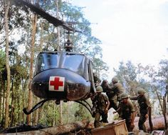 https://flic.kr/p/TwXx3L | Vietnam War 1967 - Loading casualties onto a helicopter | Members of the 173rd Airborne Brigade load casualties onto a helicopter in Vietnam in November 1967 for evacuation to a field hospital.