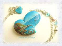 Very detailed sculpted scene on a heart necklace.  Beautiful blues and seascape.  Scenery, Le Cinque Terre, Liguria-Italy ... by FattodaCristyCry