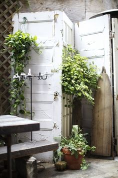 These up-cycled old doors are hinged together to create a very cool privacy screen… We would advise sealing it with a good exterior grade po...