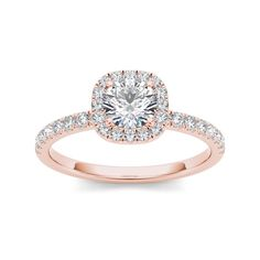 On the day you ask for her hand, wow her with this stunning engagement ring crafted in rose gold. Featuring a brilliant diamond center stone, it is surrounded by a frame of smaller accent diamonds ato