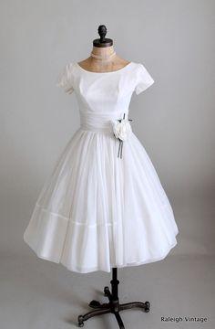 vintage 1960s wedding dress.  https://www.etsy.com/listing/110454877/vintage-1960s-dress-50s-60s-white