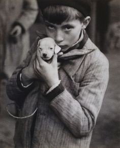 "Andre Kertesz - Boy Holding Puppy, 1928 * Extracts from Roland Barthes' Camera Lucida: ""He is looking at nothing; he reta. Andre Kertesz, Black White Photos, Black And White Photography, Andy Warhol, Claudio Edinger, Foto Face, Fotojournalismus, Camera Lucida, Street Photography"
