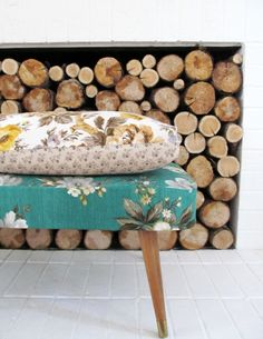 Love the vintage ottoman to sit and put shoes on.