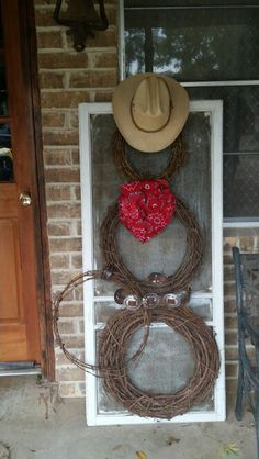 Western snowman- flea market old window and belt, thrift store wreaths, old barbed wire