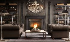 Wow comes to mind. This is one cool and badass living room setting. Love the slate grey and impressive chandelier