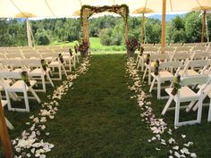 purple and white wedding flowers. I like the tent over the entire ceremony but still outside in case of rain/ too much sun