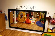 kid height mirror in the play area... so fun!