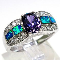 purple. and opal. (my birthstone) another amethyst blue fire opal ring...LOVE