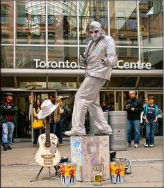 Toronto Canada  Eaton Centre 2010, (He was a statue until u dropped money in the bucket. Than he'd do a performance. -One of my faves.
