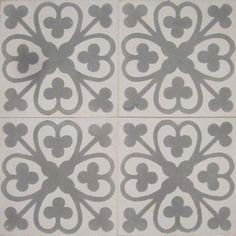 Grey and white cement deco tiles with clubs and hearts.