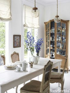 Gorgeous breakfast room - love the Rachel Ashwell pendants and antique china cabinet