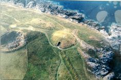 The most remarkable of the chambered tombs of Wales is Barclodiad y Gawres (the apronful of the giantess) in Anglesey. Several stones within it are decorated with spirals, chevrons and lozenges, the earliest examples of art in Wales. Examples Of Art, Ancient Buildings, Ancient Mysteries, White Horses, Small Island, Cairns, British Isles, Great Britain, Wales