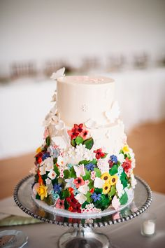 Ivory Three-tier Cake With Floral Accents | Bella Christie and Lil Z's Sweet Boutique https://www.theknot.com/marketplace/bella-christie-and-lil-zs-sweet-boutique-pittsburgh-pa-661543 | Mt. Lebanon Floral | Veronica Varos Photography https://www.theknot.com/marketplace/veronica-varos-photography-indianola-pa-766879